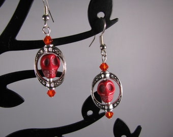 Goth or Steampunk RED Howlite skully w/ silver cameo frame and red Swarovski crystals.