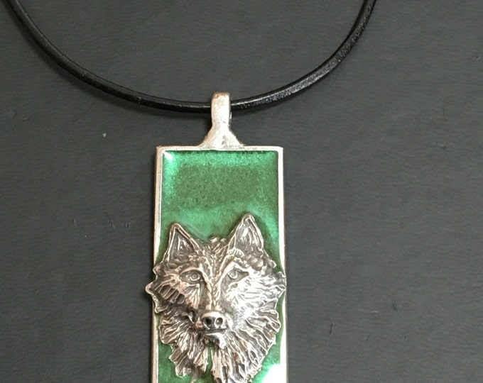 Wolf pendant with green background on leather necklace. Handmade in Australia. Pewter and Resin