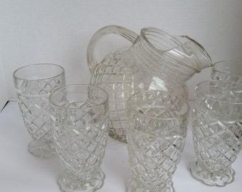 anchor hocking waterford pitcher and 5 footed tumblers