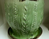 Planter with attached saucer in green, aqua or creamy white glaze over textured surface