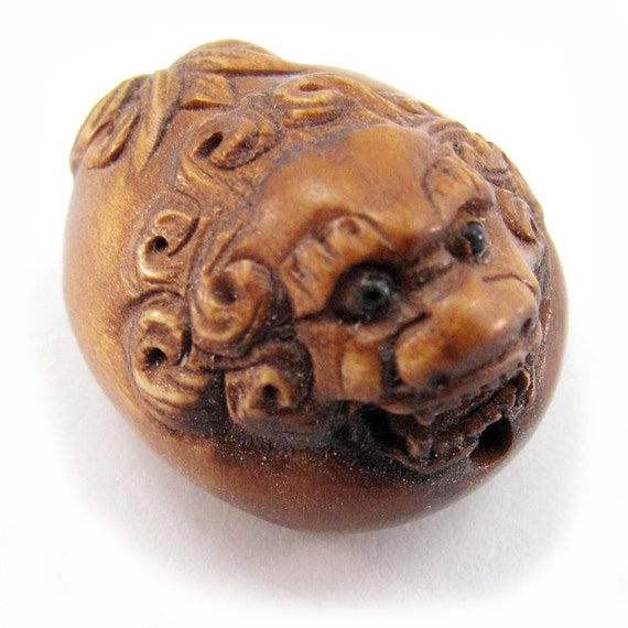 Round dragon hand carved boxwood ojime bead from