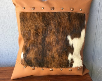 Hair on cowhide fur inset and leather pillow with beautiful studs