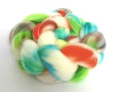Hand dyed wool fibre. 100g of superwash merino fiber.  blues, greens, white, brown, orange.  Tops for spinning.  UK Indie dyer.