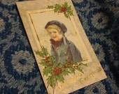 Christmas Greetings Child in Blue and Holly Embossed Antique Postcard 1915 One Cent Stamp