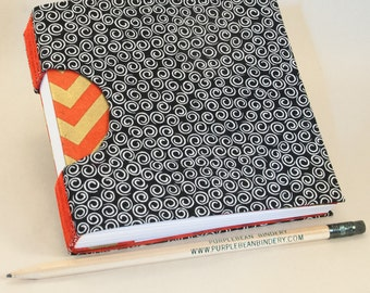A Guestbook, Square Journal or Sketchbook, Unique and Hand-Bound with Elegant Black Swirl Fabric Cover and Gold and Red Endpapers