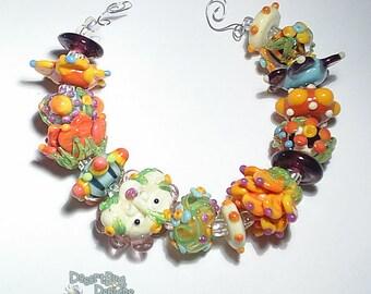 GARDEN SPRITE  Lampwork Beads Handmade Big Bold Flowers Face Color Mix Blue Ivory Green Yellow Orange Purple Set fo 15