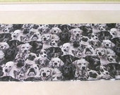 many many dogs!!  black and grey dog pet food mat or anything you could find it useful for