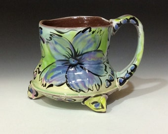 Purple flower graffiti style mug with feet and rutile copper slips