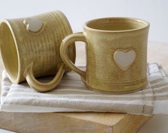 Set of two heart mugs glazed in pepper yellow - hand thrown stoneware pottery