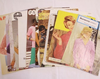 Bundle of vintage womens knitting patterns for jumpers and cardigans