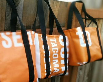 banner totes - large and sturdy, made from repurposed TriMet and New Seasons Market banners - one of a kind