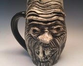 Carved Monster Face Mug with Toothy Smile