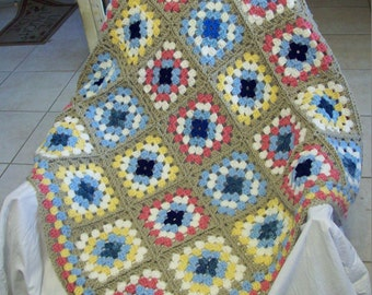 Crochet Granny Square Throw Afghan in blues, raspberry, soft white, and linen