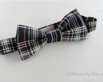 Preppy bow tie collection. Navy blue and brown plaid print
