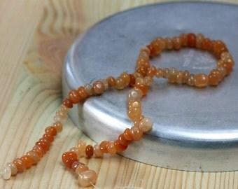 carnelian little nugget - orange tones stone