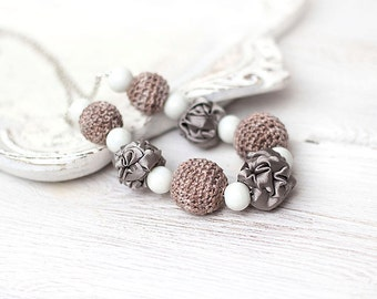 Taupe necklace with crocheted and fabric beads