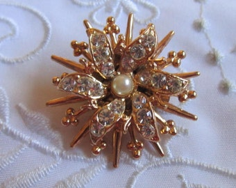 Vintage Gold Tone Flower-Shaped Brooch with Faux Pearl Center and Clear Faceted Rhinestones