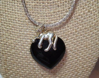 925 Silver Kitty Cat perched Upon a Black Onyx Like Heart.