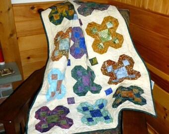Batik flowers quilt wallhanging or lap throw.