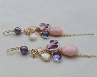 Gemstone and seashell earrings.