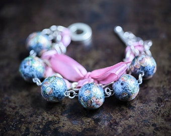 Rose Flowers on the Blue Marble Background and Orchid Ribbon Bracelet