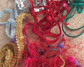 Embellishment grab bag. Assortment of remnants of sequins, chords & ribbon.
