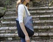 black tote bag in geometric pattern with zipper closure. vegan bag.