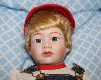 Little porcelain boy doll, haunted and strange