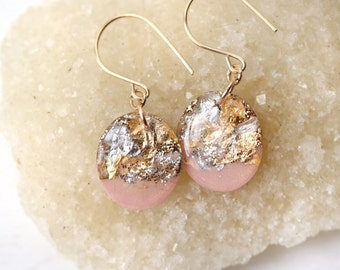 pink oval drop earrings with gold and silver leaf and glitter on 14 karat ear wires