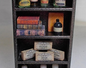 Dolls House Miniature black/gold potion/poison plant extract display.