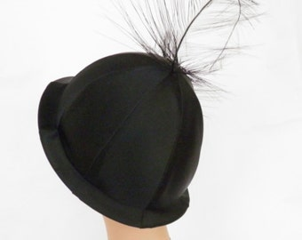 Vintage 1960s cloche hat, black satin, wild feather, Mr. John Classic