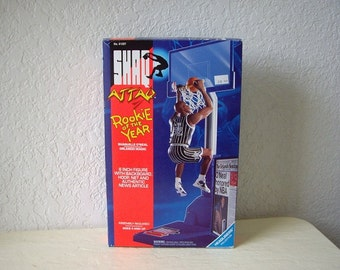 Rockie of the Year, Shaquille O'Neal six inch Figure with Backboard, Hoop, Net, Ball and Authentic News Article, 1993.