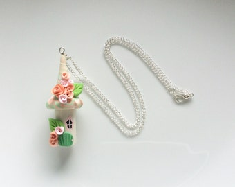 Fairy house necklace in peach and mint green colours handmade from polymer clay