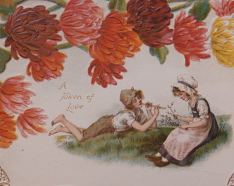 Pretty Vintage Edwardian Valentine Card Girl and Boy in Meadow A Token of Love