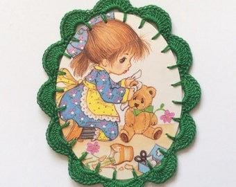 Crochet Get Well card Adorable little girl taking care of her teddy bear. With green crochet edge.