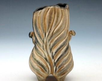 Curvy carved porcelain leaf vase, in luster golden shino with black