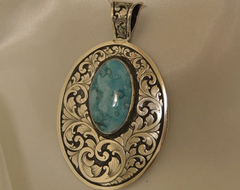 Turquoise and sterling silver engraved pendant
