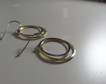 Mixed metal earrings. Hoops. Silver and gold earrings. Silver and gold hoops.