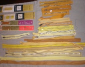 28 assorted yellow and gold vintage metal zippers