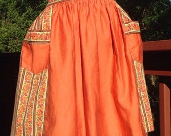 Vintage orange half Apron. coverup with flowers. Hostess apron with pockets. 50s or 60s apron