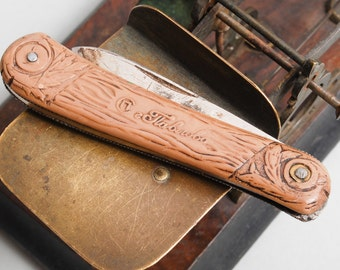 Antique metal folding knife,  with plastic handle