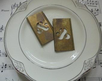 Pair of brass ampersand stencils