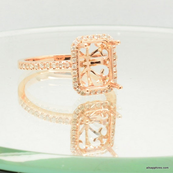 A setting gold ring here in rose gold engagement ring