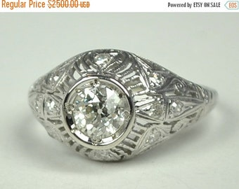 ON SALE Art Deco Platinum Ring with a .68 Carat Center Stone. A Delightfully Gorgeous Ring!