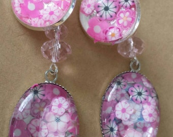 Sale was 18 now 16uk Silvertone Oval Cabochon Pink faux milli fiori earrings with Crystal dangles.