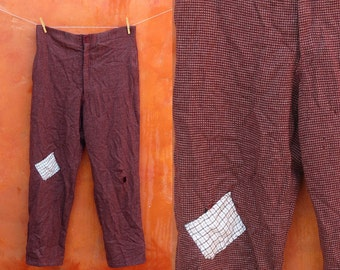 Vintage 1950s 1960s men's plaid hobo pants. Distressed torn shabby patched. patchwork clown pants bum suspender buttons black burgundy tweed