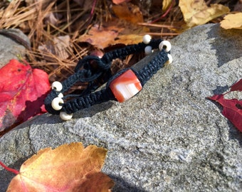 Black Hemp Bracelet With A Beautiful Orange And White Agate Center Bead And Bone Beads On The Sides