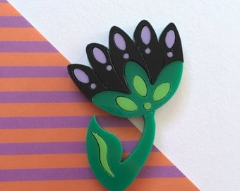 Black and lilac flower brooch