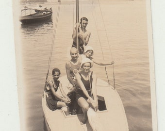 Vintage/Antique beautiful photo of a family  in  vintage bathing suits on a sailboat