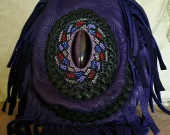 Purple beaded deerskin pouch